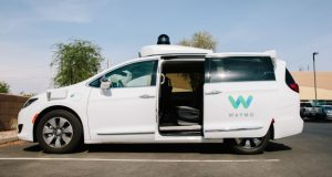 A Waymo Chrysler Pacifica autonomous vehicle in Arizona in July. Waymo says its vehicles are designed to pull over if it detects police sirens behind it, and the vehicles can unlock doors and roll down windows to allow someone from the company's support team to communicate with law enforcement.  Caitlin o'hara/bloomberg