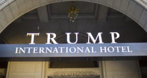 A Sept. 12, 2016 file photo of the Trump International Hotel in downtown Washington. The Justice Department is challenging a Maryland federal judge's decision to allow a case accusing President Donald Trump of profiting off the presidency to proceed in district court. It wants an appeals court to take up the case instead. (AP Photo/Pablo Martinez Monsivais, File)