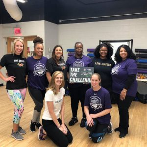 United Way volunteers and staff at the annual Baltimore Ravens Hometown Huddle, part of a NFL-wide day of service to encourage youth to be healthy and active. Volunteers included players from the Baltimore Ravens, The United Way, Playworks Maryland and members of the Lady Ravens.