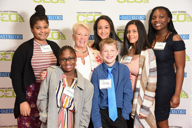 Bonnae Meshulam, third from left, executive director of the Boys & Girls Club of Westminster, gets a photo with some club members who attended the event to celebrate Meshulam's Most Admired CEO award. (Photo by Maximilian Franz)