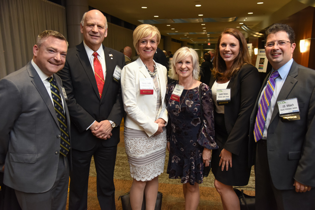 From left, Andy Dalton and Steve Edwards of Edwards Performance Solutions; 2018 Most Admired CEO winners Stacey Smith, of Cybersecurity Association of Maryland Inc.; snd Gina Abate, of Edwards Performance Solutions; Sarah Peter, of Bellamy Genn Group, and J.D. Urbach of Edwards Performance Solutions, take some time out from the networking event to pose for a photo. (Photo by Maximilian Franz)