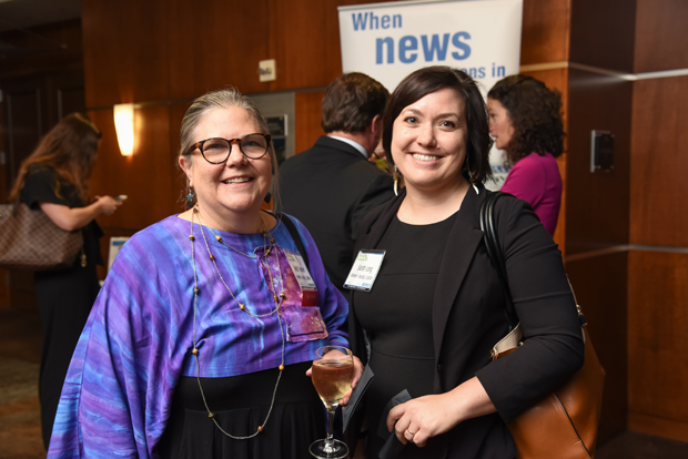 2018 Most Admired CEO winner Beth Benner, left, executive director of the Women's Housing Coalition, poses with colleague Sarah Long, the coalition's development manager, during the networking reception at the event. (Photo by Maximilian Franz)