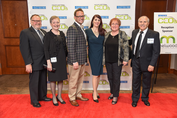 From left, Ben Overbay, Jane Overbay, Steven Overbay, 2018 Most Admired CEO winner Luisa Caiazzo, with the Sexual Assault Spouse Abuse Resource Center, Maria Caiazzo and Angelo Caiazzo pose on the red carpet. (Photo by Maximilian Franz)