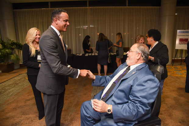 2018 Most Admired CEOs winners Rene LaVigne, president and CEO of Iron Bow Technologies, and Timothy Adams, president and CEO of Systems Application & Technologies, Inc. shake hands during the networking reception. (Photo by Maximilian Franz)