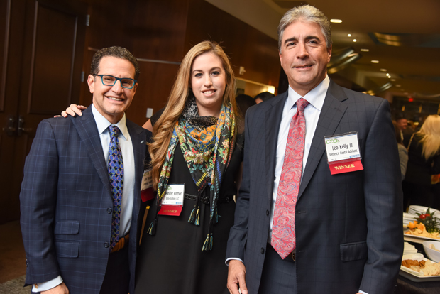 From left, 2018 Most Admired CEO winners Neil Meltzer, president and CEO of LifeBridge Health; Jennifer Rotner, founder and CEO of Elite Editing LLC; and Leo Kelly, founder and CEO of Verdence Capital Advisors, pause during the networking reception. (Photo by Maximilian Franz)