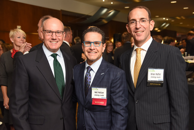From left, Jeffrey Wothers, managing partner at law firm Niles, Barton & Wilmer LLP; 2018 Most Admired CEO winner Neil Meltzer, president and CEO of LifeBridge Health; and Brian Moffet pose for a photo during the reception. (Photo by Maximilian Franz)