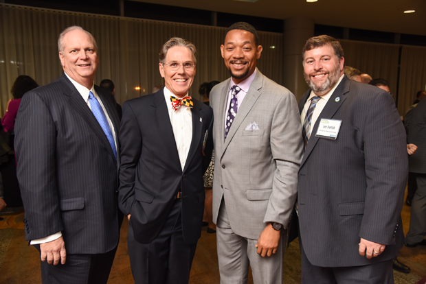 From left, 2018 Most Admired CEO winner Donald C. Fry, president and CEO of the Greater Baltimore Committee; 2018 Most Admired CEO winner Lyle E. Sheldon, president and CEO of Upper Chesapeake Health; Franklyn Baker, president and CEO of United Way of Central Maryland; and Len Parrish, director of the Harford County Office of Community and Economic Development, pose during the networking reception. (Photo by Maximilian Franz)