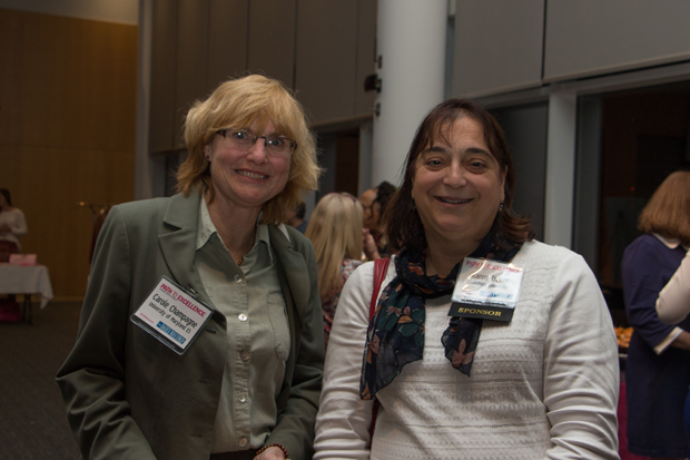 Carole Champagne, an associate professor of English at the University of Maryland, Eastern Shore, gets a photo with Karen Treber, general counsel with Salisbury University, during the Path to Excellence networking event. (Photo by Kathleen Kaste)