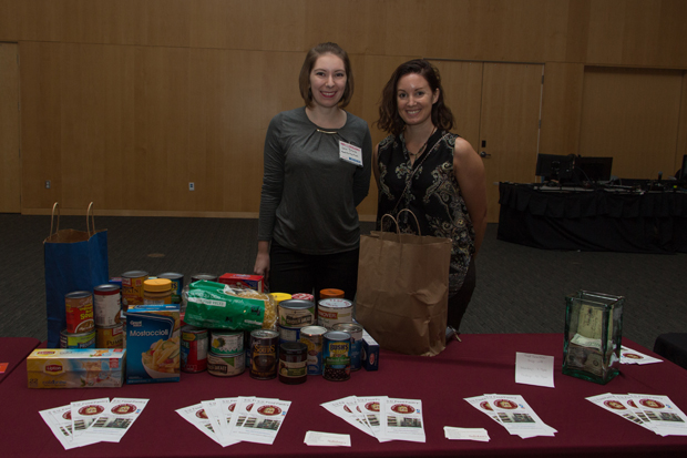 The nonprofit beneficiary at the event was Food for the Flock a student organization based at Salisbury University whose mission is to combat social stigma by providing food for students at the school experiencing food insecurity. Lexi Sank, left, with Food for the Flock, stands with Lisa Howard, the faculty adviser for the organization, next to the donations received from event attendees. (Photo by Kathleen Kaste)