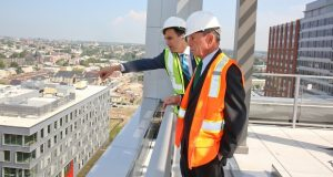Michael R. Bloomberg, right, with Johns Hopkins University President Ronald Daniels surveys campus construction projects during a recent visit. (Submitted photo)