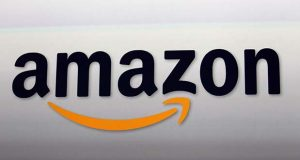 "FILE - This Sept. 6, 2012, file photo, shows the Amazon logo in Santa Monica, Calif.    Amazon Inc. is in ""advanced talks"" to open its second headquarters in the Washington, D.C., metropolitan area, The Washington Post reported Saturday, Nov. 3, 2018.  Amazon, based in Seattle, is apparently seriously considering an area known as Crystal City. It's a large residential and office complex in Arlington, Virginia, just south of Washington, the Post said, citing unidentified sources.  (AP Photo/Reed Saxon, File)"