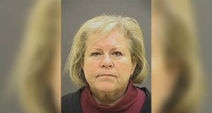 FILE - This undated file photo provided by the Baltimore Police Department shows former Episcopal Bishop Heather Cook. A Maryland judge is set to decide whether to reduce a prison sentence for the former Episcopal bishop who was drunk and texting when she struck and killed a bicyclist with her vehicle. The Baltimore Sun reports that Baltimore Circuit Judge Timothy Doory is scheduled to preside over a hearing Monday, Nov. 5, 2018, for Cook's request for a reduction in her five-year sentence. The 62-year-old Cook has served approximately three years of her sentence for the 2014 collision that killed Thomas Palermo. (Baltimore Police Department via AP, File)