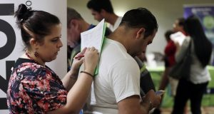 Loredana Gonzalez, of Doral, Florida., fills out a job application at a JobNewsUSA job fair in Miami Lakes in January. (AP Photo/Lynne Sladky, File)