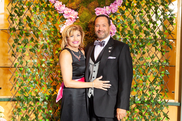 "Event honorary co-chairs Sandi Linkous, a community volunteer, and Steve Linkous, president/CEO of Harford Mutual Insurance Company pose for a photo during the Harford County Public Library Foundation's 14th annual gala ""An Evening in the Stacks -- The Pink Edition."" (Photo by Aven Love Studios)"