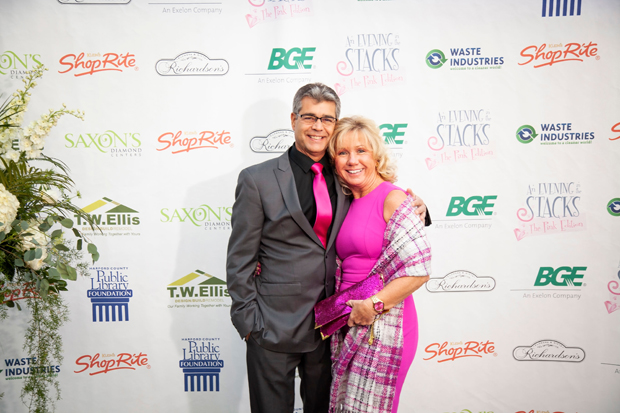 """James Kerner, superintendent with Plano-Coudon, gets a photo at the Harford County Public Library Foundation's 14th annual gala """"An Evening in the Stacks -- The Pink Edition, """" with Lynn Kerner, in corporate relations with Baltimore Gas & Electric. (Photo by Aven Love Studios)"""