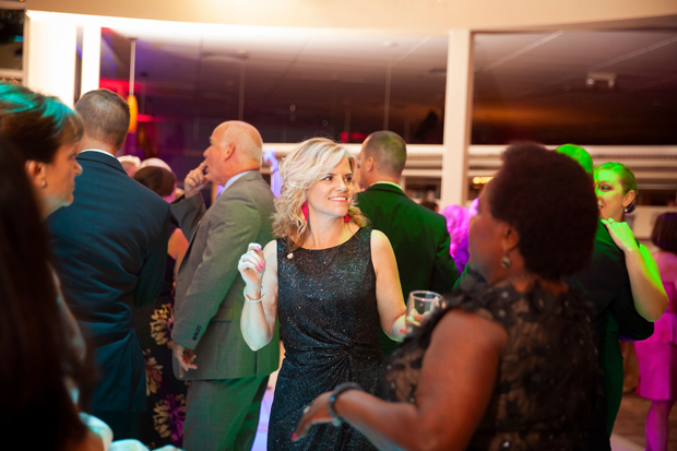 "Stacey Rebbert, center, the director of marketing & corporate communications with Harford Mutual Insurance, and Mary Teddy Wray DDS, center right, CEO of Laurel Bush Family Dentistry, dance to music from the band Mood Swings the Harford County Public Library Foundation's 14th annual gala ""An Evening in the Stacks -- The Pink Edition."" (Photo by Aven Love Studios)"