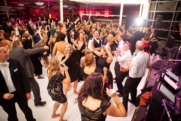 """Guests at the Harford County Public Library Foundation's 14th annual gala """"An Evening in the Stacks -- The Pink Edition"""" got on the dance floor at the Abingdon Library and enjoyed the entertainment of the band Mood Swings. (Photo by Aven Love Studios)"""