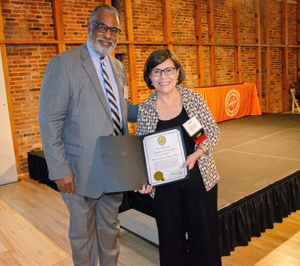 Maryland Volunteer Lawyers Service Executive Director Bonnie Sullivan displays a certificate of recognition presented to the group by Baltimore City Solicitor Andre M. Davis on behalf of the citizens of Baltimore during the Celebrate Pro Bono awards event. (Photo courtesy of MSBA)