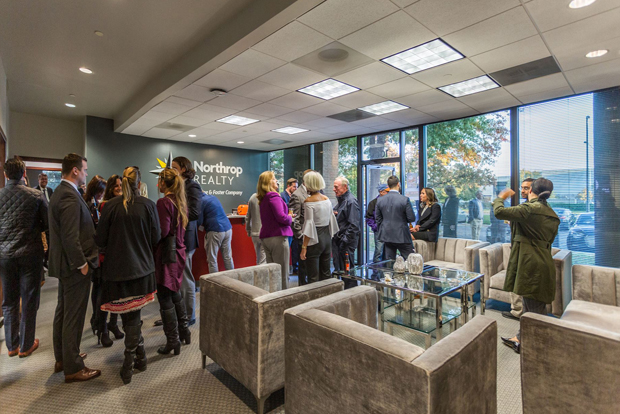 Guests mingle in the lobby while enjoying hors d'oeuvres, music and tours of the new office during the grand opening of Northrop Realty's new office location in Annapolis. (Photo courtesy of Northrop Realty)