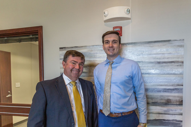 Associate Broker/Realtor David McCollough, left, and Realtor Joshua Carson enjoy their time at the grand opening of Northrop Realty's new office in Annapolis. (Photo courtesy of Northrop Realty)