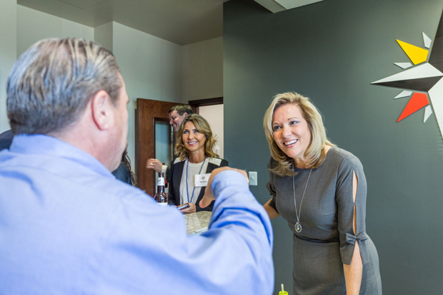 Realtor Renee Durakis, center, and Northrop Realty's vice president and CEO Carla Northrop chat with guests during the grand opening of the company's newest office location in Annapolis. (Photo courtesy of Northrop Realty)