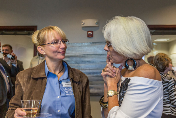 Karen Cline, right, the director of business development/COO with the Anne Arundel County Chamber of Commerce, chats with a guest at the grand opening celebration of Northrop Realty's new office location in Annapolis. (Photo courtesy of Northrop Realty)