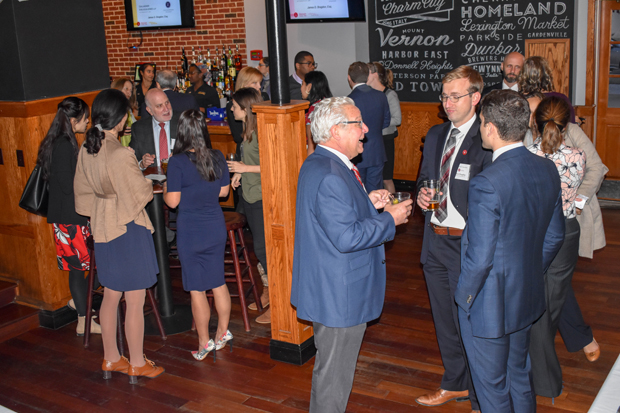 James D. Bragdon, center right, a member of the litigation group at Gallagher, Evelius & Jones LLP, enjoys a conversation with other guests during the launch party for The Equal Justice Associates at the Pratt Street Ale House. (Photo by Bill Hall, MSBA)