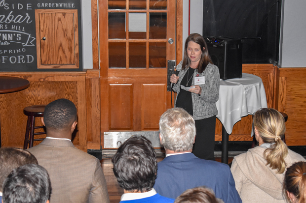 Megan E. Davis, Esq., a trial attorney with the  Federal Communications Commission and an at-large member of the leadership group for The Equal Justice Associates, takes an opportunity to speak during a launch party for the group at the Pratt Street Ale House. (Photo by Bill Hall, MSBA)