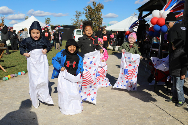 Family friendly events at the fourth annual Stars, Stripes & Chow chili cookoff  included sack races in the Kids Zone and activities for all ages. (Photo courtesy of The Baltimore Station)