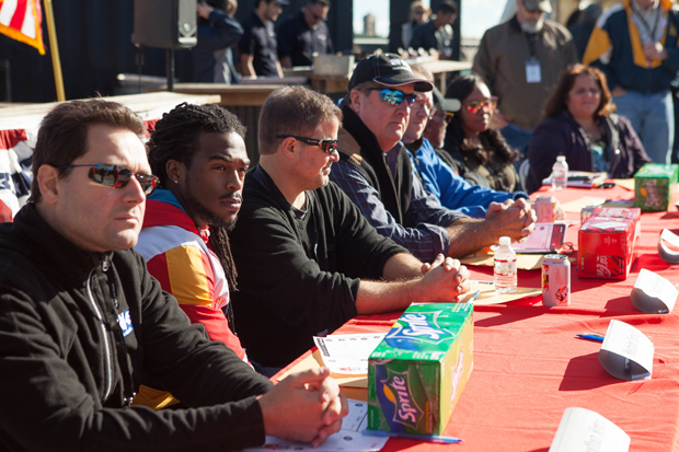 The panel of judges for the fourth annual Stars, Stripes & Chow chili cookoff included, from  left, Jonathan Myers, a meteorologist from WBFF-TV, FOX 45; Maurice Canady, a cornerback with the Baltimore Ravens; Doug Kurzmiller, a volunteer from Severna Park Evangelical Presbyterian Church; Scott Stevens, president of Modu Tech; Dave Olson, owner of La Tavola Italian Restaurant; Al Bumbry, former Baltimore Orioles outfielder; Kenesha Bailey, The Baltimore Station's Nutritional Program Coordinator through Strong City Baltimore and AmeriCorps VISTA; and Natalie Arteen, corporate events and volunteer coordinator with M&T Bank. (Photo courtesy of The Baltimore Station)
