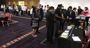 FILE- In this June 20, 2018, file photo people attend a job fair in Chicago. On Friday, Dec. 7, the U.S. government issues the November jobs report. (AP Photo/Annie Rice)