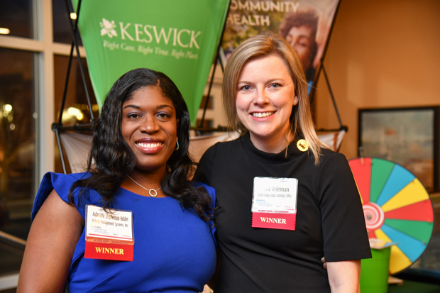 From left, 2018 Leading Women honorees Aubreana Stephenson Holder, chief operating officer with Federal Management Systems Inc., and Cara Frieman, with the Carroll County State's Attorney's Office, pause during the opening reception. (Photo by Maximilian Franz)