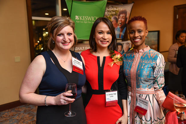 From left, 2018 Leading Women honorees Amy Rogers, senior digital producer and development team lead with Havas Helia North America; Dr. Genevieve Regal, a clinical consultant with Confidio; Chichi Nyagah-Nash, director of special projects with the Baltimore City Department of Housing and Urban Development pose for a photo during the opening reception. (Photo by Maximilian Franz)