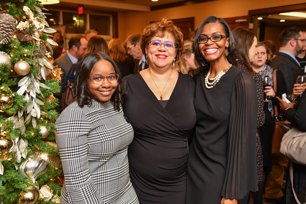 Top 100 Women honoree Maria P. Rodriguez, program director with the Featherstone Foundation, center, stands with 2018 Leading Women honorees Shantell Lenis Roberts, founder of Touching Young Lives, Inc., and Lanaea Featherstone, president and co-founder of the William & Lanaea C. Featherstone Foundation. (Photo by Maximilian Franz)