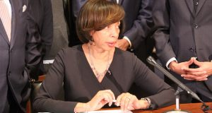 Mayor Catherine Pugh prepares to sign a bill providing $13 million for  Baltimore's Affordable Housing Trust Fund on Wednesday at City Hall. (Adam Bednar)