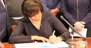 Mayor Catherine Pugh signs a bill at City Hall on Wednesday raising transfer and recordation fees on properties that sell for at least $1 million. The revenues are expected to provide $13 million annually to Baltimore's Affordable Housing Trust Fund. (The Daily Record / Adam Bednar)
