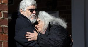 Susan Bro, mother of Heather Heyer, hugs her husband, Kent in front of Charlottesville Circuit Court after a jury recommended life plus 419 years for James Alex Fields Jr. for the death of Heyer as well as several other charges related to the Unite the Right rally in 2017 in Charlottesville, Va., Tuesday, Dec. 11, 2018. (AP Photo/Steve Helber)