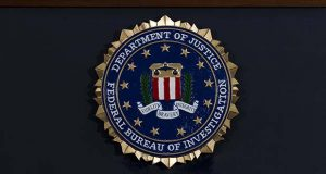"FILE - In this June 14, 2018, file photo, the FBI seal is seen before a news conference at FBI headquarters in Washington. The FBI is grappling with a seemingly endless cycle of money laundering schemes that law enforcement officials say they're scrambling to slow through a combination of prosecution and public awareness. Beyond the run-of-the-mill plots, officials say, is a particularly concerning trend involving ""money mules."" These are people who, unwittingly or not, use their own bank accounts to move money for criminals for purposes they think are legitimate or even noble.  (AP Photo/Jose Luis Magana, File)"