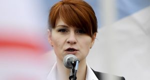 """FILE - In this April 21, 2013 file photo, Maria Butina, leader of a pro-gun organization in Russia, speaks to a crowd during a rally in support of legalizing the possession of handguns in Moscow, Russia. Prosecutors say they have """"resolved"""" a case against Butina accused of being a secret agent for the Russian government, a sign that she likely has taken a plea deal. The information was included in a court filing Monday.   (AP Photo/File)"""
