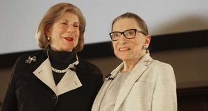 NPR's Nina Totenberg, left, and U.S. Supreme Court Justice Ruth Bader Ginsburg stand onstage at the New York Academy of Medicine after doing a question and answer session as part of the Museum of the City of New York's David Berg Distinguished Speakers Series Saturday, Dec. 15, 2018, in New York. Totenberg questioned Ginsburg on her health, the state of the Supreme Court, and the upcoming biopic about her life. (AP Photo/Rebecca Gibian)