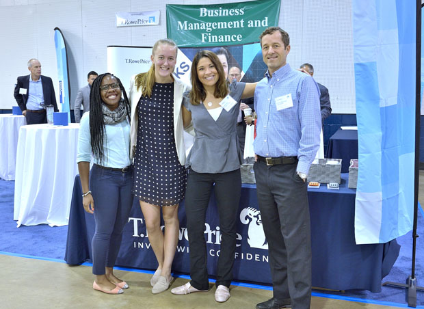 From left, T. Rowe Price colleagues Samantha Sebanakitta, a talent acquisition coordinator; Hana Tankersley, a production support programmer analyst; Katie Vicino, a talent acquisition coordinator; and Chris Marshall, a business, product and delivery senior manager, enjoy their time at the launching of Junior Achievement of Central Maryland's JA Inspire initiative. (Photo by Tom O'Connor)