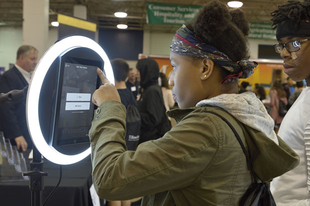 A Baltimore County middle-school student visits the Maryland Association of Certified Public Accountants' exhibit to use the FutureMe platform, which matches their skills and interests with a job in accounting. (Photo by Tom O'Connor)
