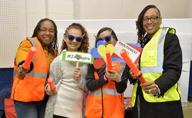 Some Baltimore County middle-school students get a photo at the Southwest Airlines presentation, where they learned about transportation careers, such as becoming an aircraft marshal. (Photo by Tom O'Connor)