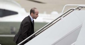 "FILE - In this Nov. 2, 2018, file photo, President Donald Trump's White House Senior Adviser Stephen Miller boards Air Force One for campaign rallies in West Virginia and Indiana, in Andrews Air Force Base, Md. The White House is digging in on its demand for $5 billion to build a border wall as congressional Democrats stand firm against it, pushing the federal government closer to the brink of a partial shutdown. Miller says Trump is prepared to do ""whatever is necessary"" to build a wall along the U.S.-Mexico border. (AP Photo/Evan Vucci, File)"