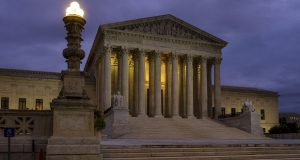 The U. S. Supreme Court building stands quietly before dawn in Washington. The Constitution says you can't be tried twice for the same offense. And yet Terance Gamble is sitting in prison today because he was prosecuted separately by Alabama and the federal government for having a gun after an earlier robbery conviction. The Supreme Court is considering Gamble's case Thursday, Dec. 6, and the outcome could have a spillover effect on the investigation into Russian meddling in the 2016 election. (AP Photo/J. David Ake, File)