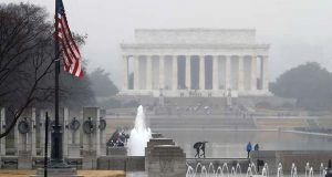 With the Lincoln Memorial in the background, an American flag at the WWII Memorial flies at half-staff, Saturday, Dec. 1, 2018, in Washington, after President Donald Trump directed that American flags be flown at half-staff for 30 days to honor the memory of former President George H.W. Bush. (AP Photo/Jacquelyn Martin)