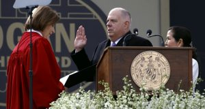 Maryland Gov. Larry Hogan, center, accompanied by his wife Yumi, right, takes a ceremonial oath of office administered by Mary Ellen Barbera, Chief Judge of the Maryland Court of Appeals, at his inauguration ceremony, Wednesday, Jan. 16, 2019, in Annapolis, Md. Hogan is the first Republican governor to be re-elected in the state since the 1950s. (AP Photo/Patrick Semansky)