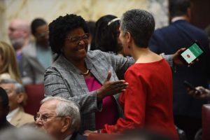 Sen. Mary Washington, (D-District 43), talks with Sen. Cheryl C. Kagan, (D-District 17), on the opening day of the 2019 General Assembly session. (Maximilian Franz / Contributing Photographer)