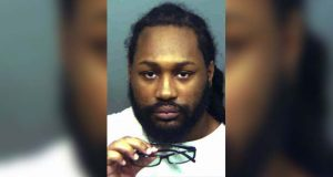 FILE - This undated file photo provided by the state's attorney's office in Prince George's County, Md., shows Michael Ford, charged with attacking a Maryland police station while his two brothers videotaped the shootout, which led to an officer mistakenly killing an undercover detective. Michael Ford faces a prison sentence for his conviction on a murder charge in the friendly-fire killing of an undercover detective who tried to end the gunman's attack. He is scheduled to be sentenced by a Prince George's County judge on Thursday, Jan. 10, 2019. (Prince George's County State's Attorney's Office via AP)
