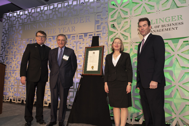 Rev. Brian F. Linnane, S.J., far left, president of Loyola University Maryland; Kathleen A. Getz, Ph.D., second from right, dean of the Sellinger School of Business and Management; and Mark Weigman, far right, vice president and portfolio manager with T. Rowe Price, celebrate with Tom S. Bozzuto, chairman and co-founder of The Bozzuto Group, as Buzzuto receives his 2018 Business Leader of the Year award. (Photo by Larry Canner Photography)